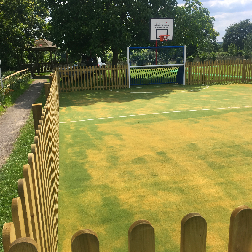 Picket fencing surrounding the newly laid synthetic surface on this MUGA